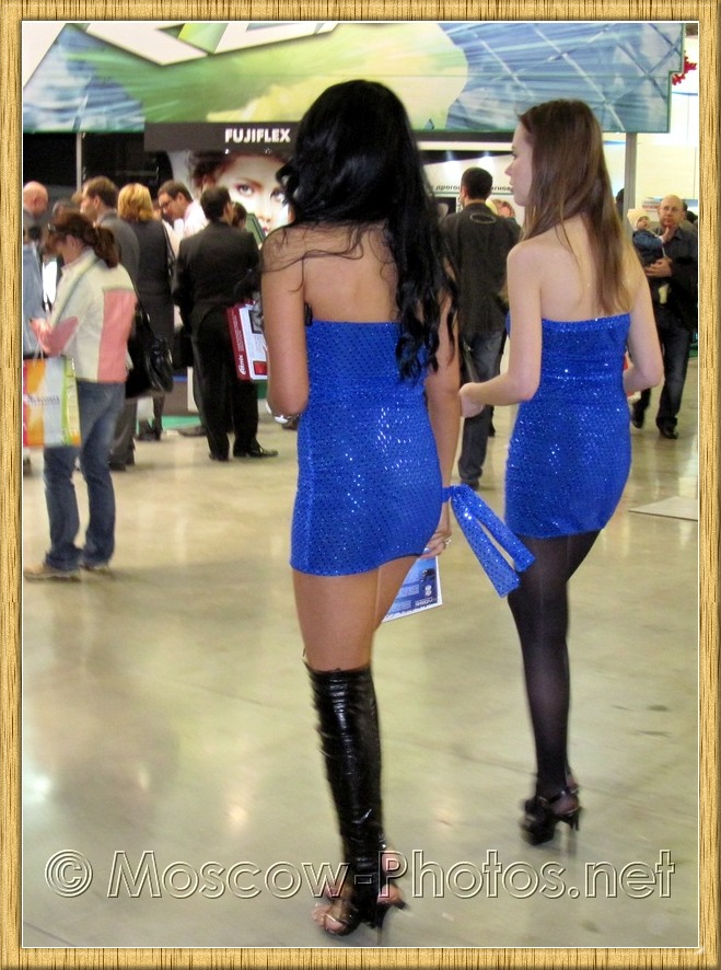 Promotional models in blue mini dresses