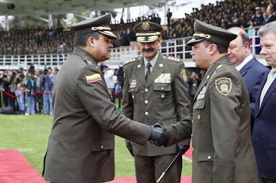 Colombia's outgoing police chief Rodolfo Palomino watches his successor being sworn in ...