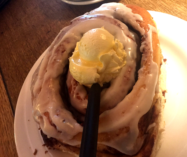 Enormous and delicious homemade cinnamon roll at Camp 18.