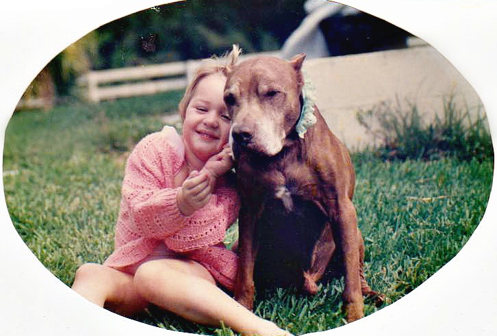 The bond between a rescued pitbull and his little girl