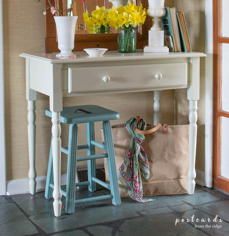 painted stool and desk in an entry