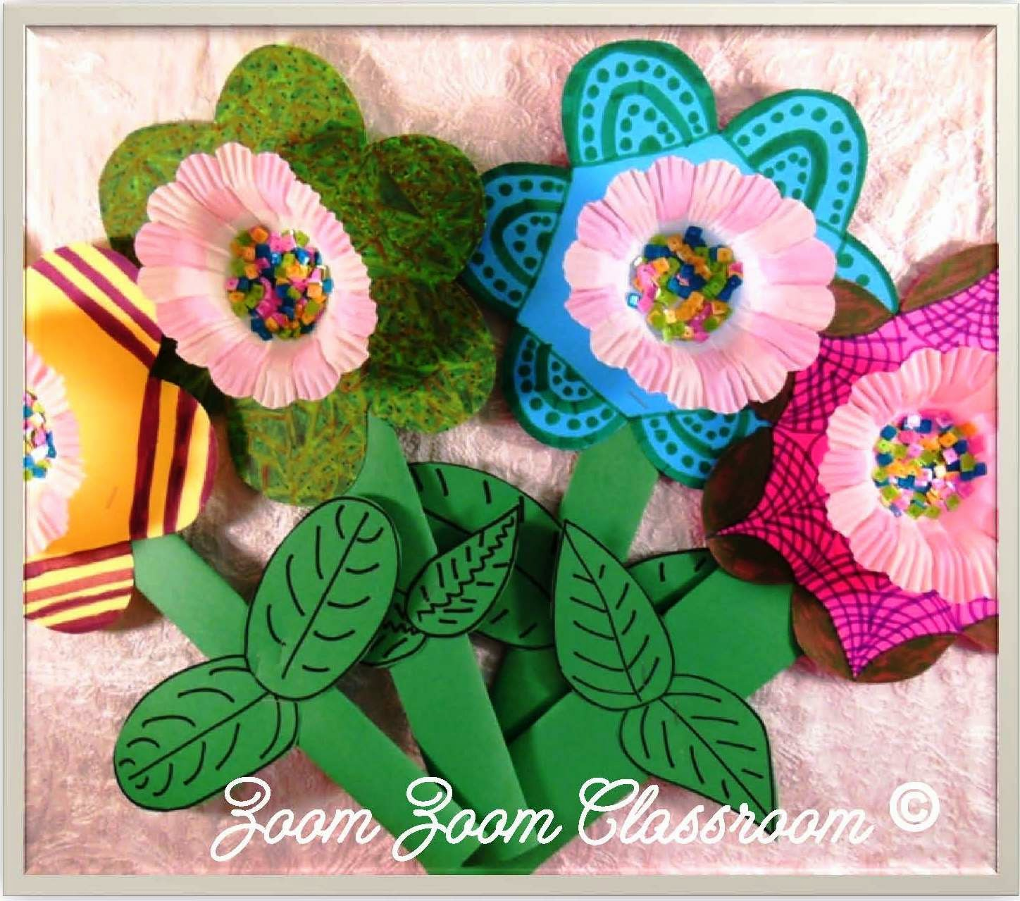 "This flower craft is easy to make and is sure to bring a smile to the face of any mother on Mother's Day!  Click the image of the black-line tropical flower to get the free pattern! Then trace it on poster board.  Allow the children to decorate the flowers with magic markers making each flower unique.  Glue or fasten cupcake liners inside the centers of the flowers.  The ""seeds"" are sequins that are glued inside the cupcake liners.  The stem and leaves are made from green construction paper."