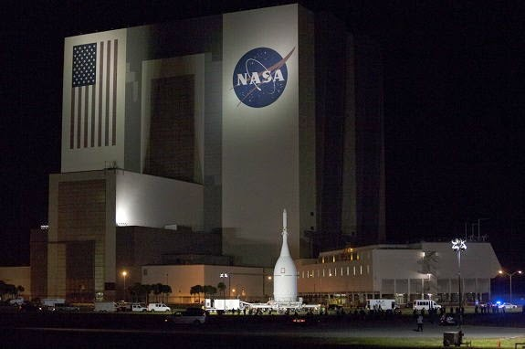 Orion spacecraft passes the Vehicle Assembly Building
