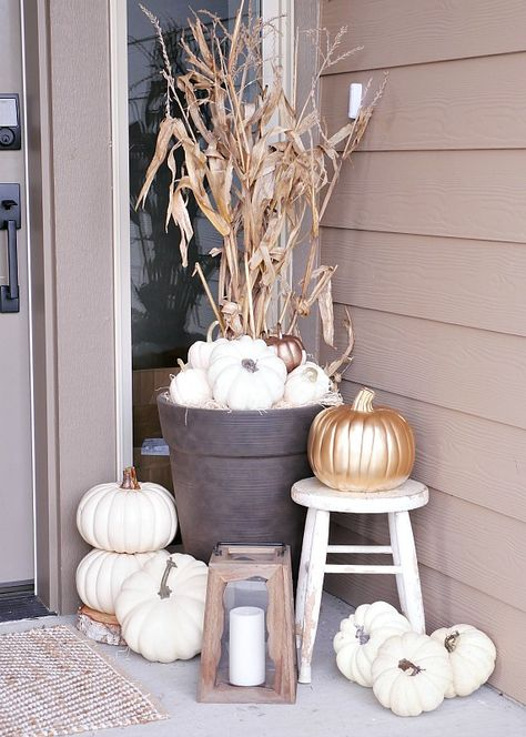 white pumpkins on front porch