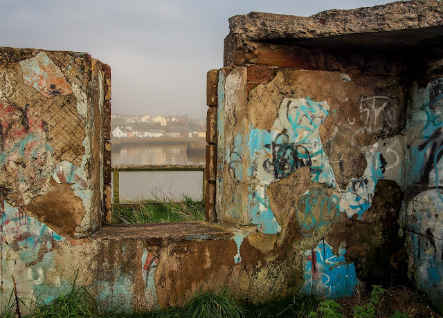 A close up photo of the graffiti with a view to the town of Maryport