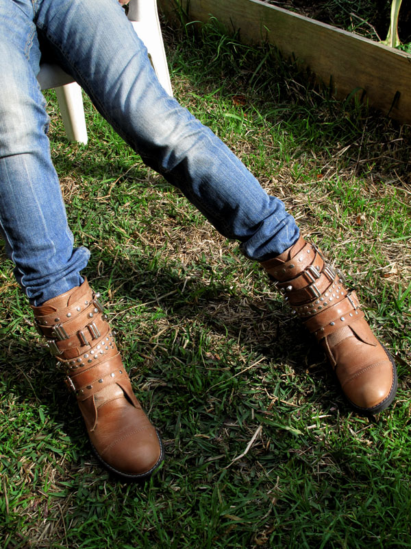 Argentina Boots and Blue jeans, sitting on the grass in a Marrickville backyard
