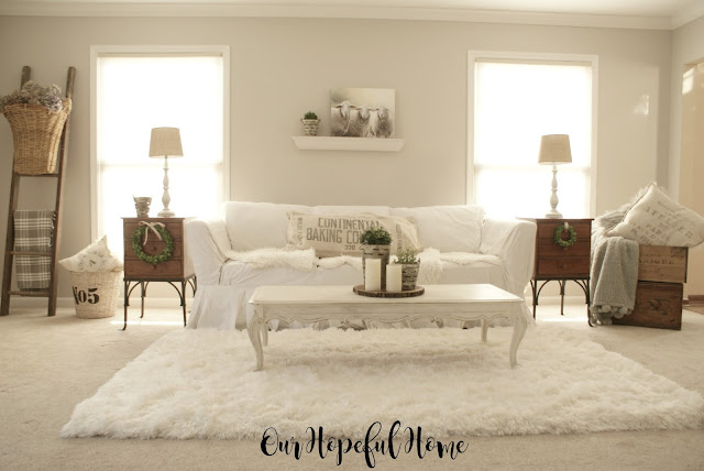 French farmhouse living room reveal white slipcovers shag rug rustic ladder