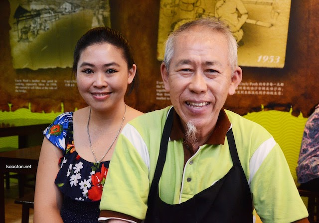 Uncle Peoh with his daughter, Mrs Ang posing for the camera