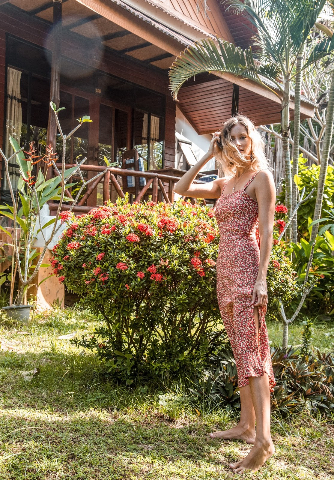 Fashion blogger, Alison Hutchinson, wears a Faithfull Katergo Midi Dress in blossom village print