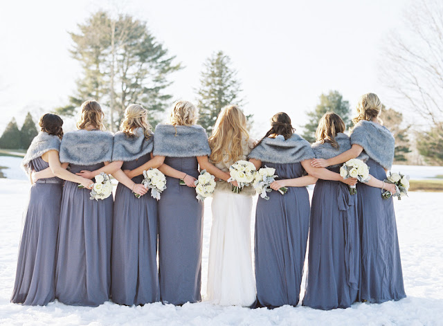 Bridesmaids from behind in purple and fur for Jenna and Chad's wintery Willow Ridge Country Club Wedding | Karen Hill Photography