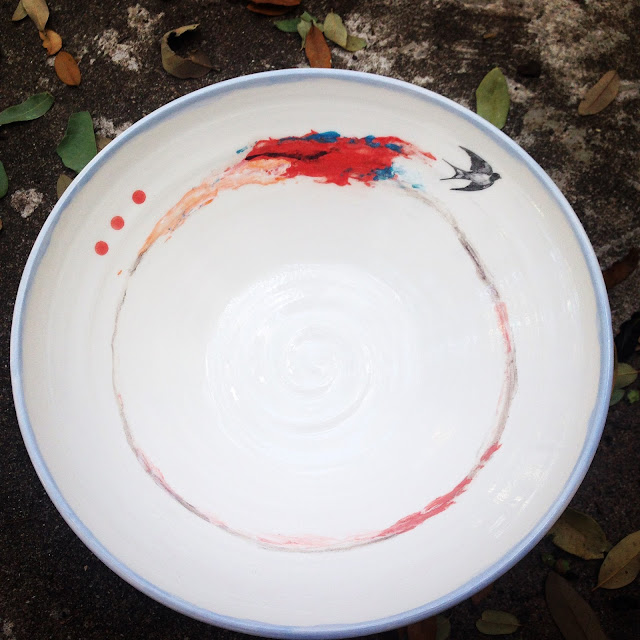 Abstract ceramic bowl with bird