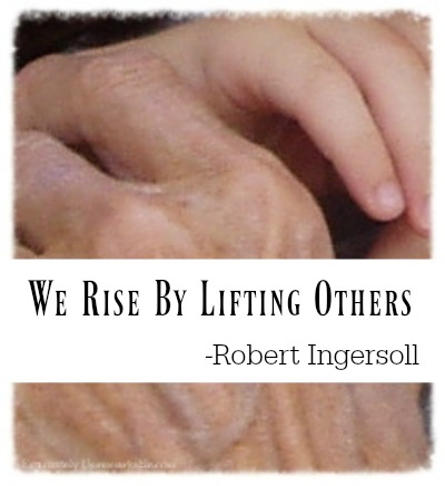We Rise By Lifting Others Quote over photo of hands