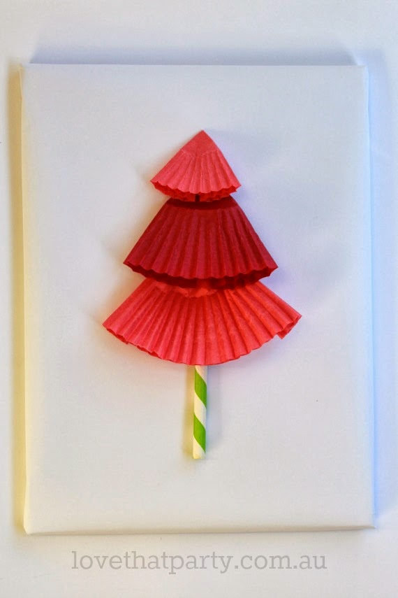 Easy DIY Christmas Tree Gift Wrap using cupcake wrappers and paper straws. So cute! www.lovethatparty.com.au