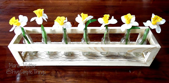 recycled bottles wood and chicken wire for a springtime flower centerpiece