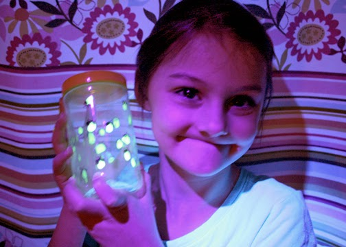 "Tessa's completed ""Glow-in-the-Dark Firefly Jar."" Pretty cool, huh? Tessa adores it so much that she keeps it beside her bed at night."