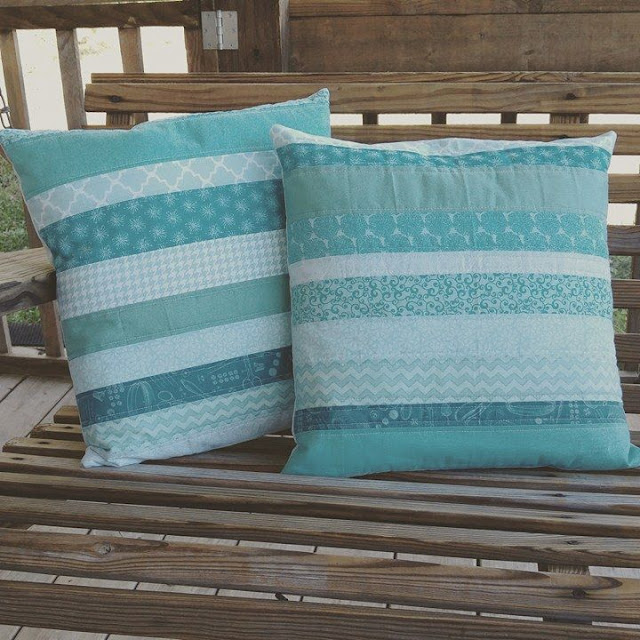 Strip pieced aqua quilted pillow