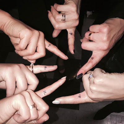 PLL cast (Lucy Hale, Ashley Benson, Shay Mitchell, Troian Bellisario, Sasha Pieterse, Janel Parrish) matching tattoos on Shh index finger