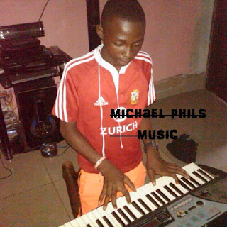 Young nigerian boy playing and practicing the piano