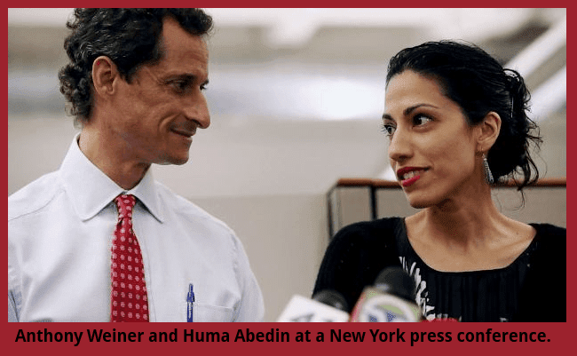 Anthony Weiner and Huma Abedin chat before a press conference.