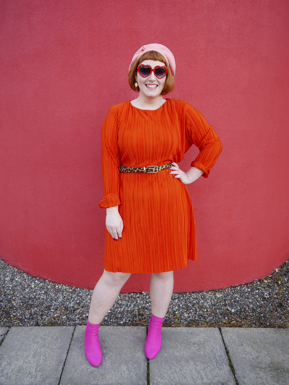 Colourful outfit with heart sunglasses, pink berret, red dress and pink boots