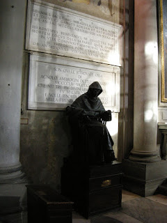 Benivieni's tombstone behind the statue of Savonarola in the Church of San Marco
