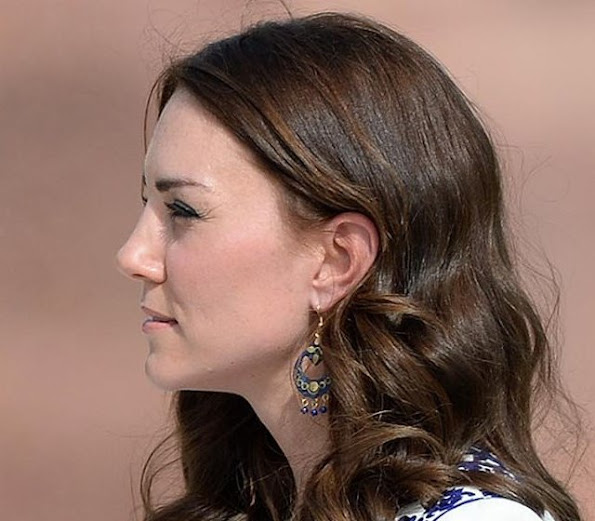 Kate wore the blue earrings she purchased during her hike to Tiger's Nest