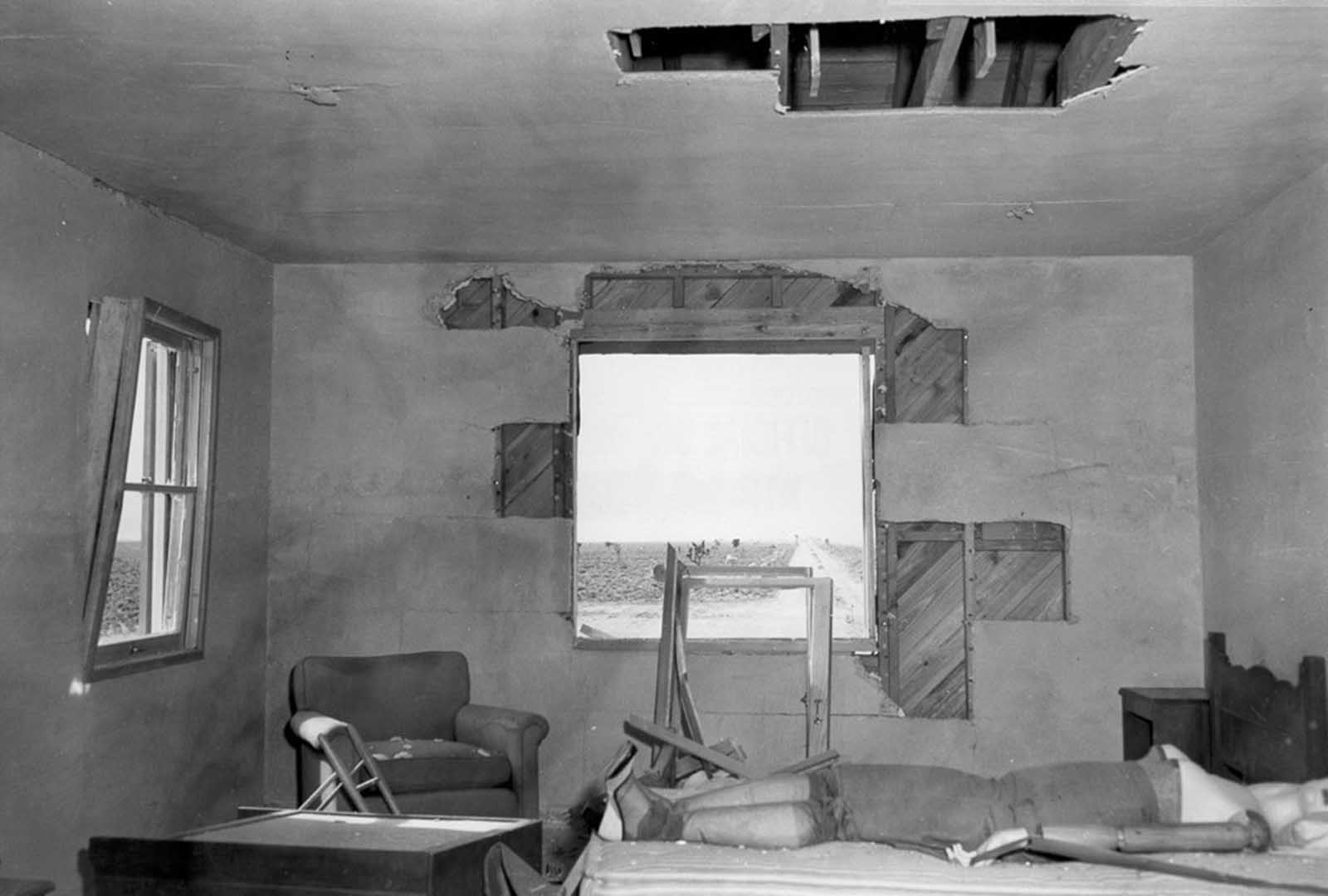 (2 of 2) After the blast, a damaged bedroom, window and blankets missing, resulting from a test during an atomic blast on March 17, 1953.