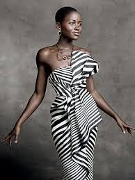 Lupita Nyong'o wearing closely cropped and lined natural hair style