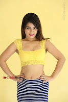 Cute Telugu Actress Shunaya Solanki High Definition Spicy Pos in Yellow Top and Skirt  0116.JPG