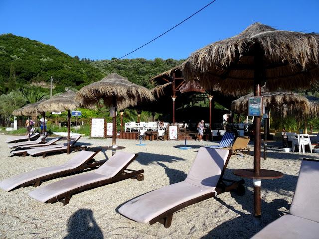 Sunbeds parasols agrios beach bar meganisi