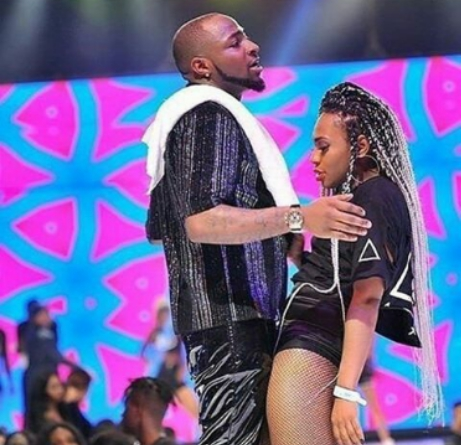 Caption This Photo Of A Slay Mama Rocking Davido On Stage (Best Caption Wins)