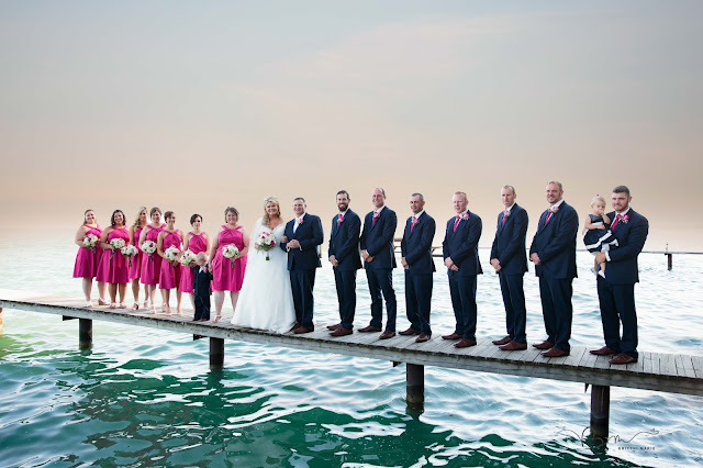 bridal party on pier at new baltimore waterfront wedding