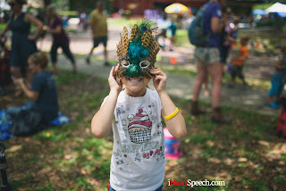 little girl with Marti Gras mask