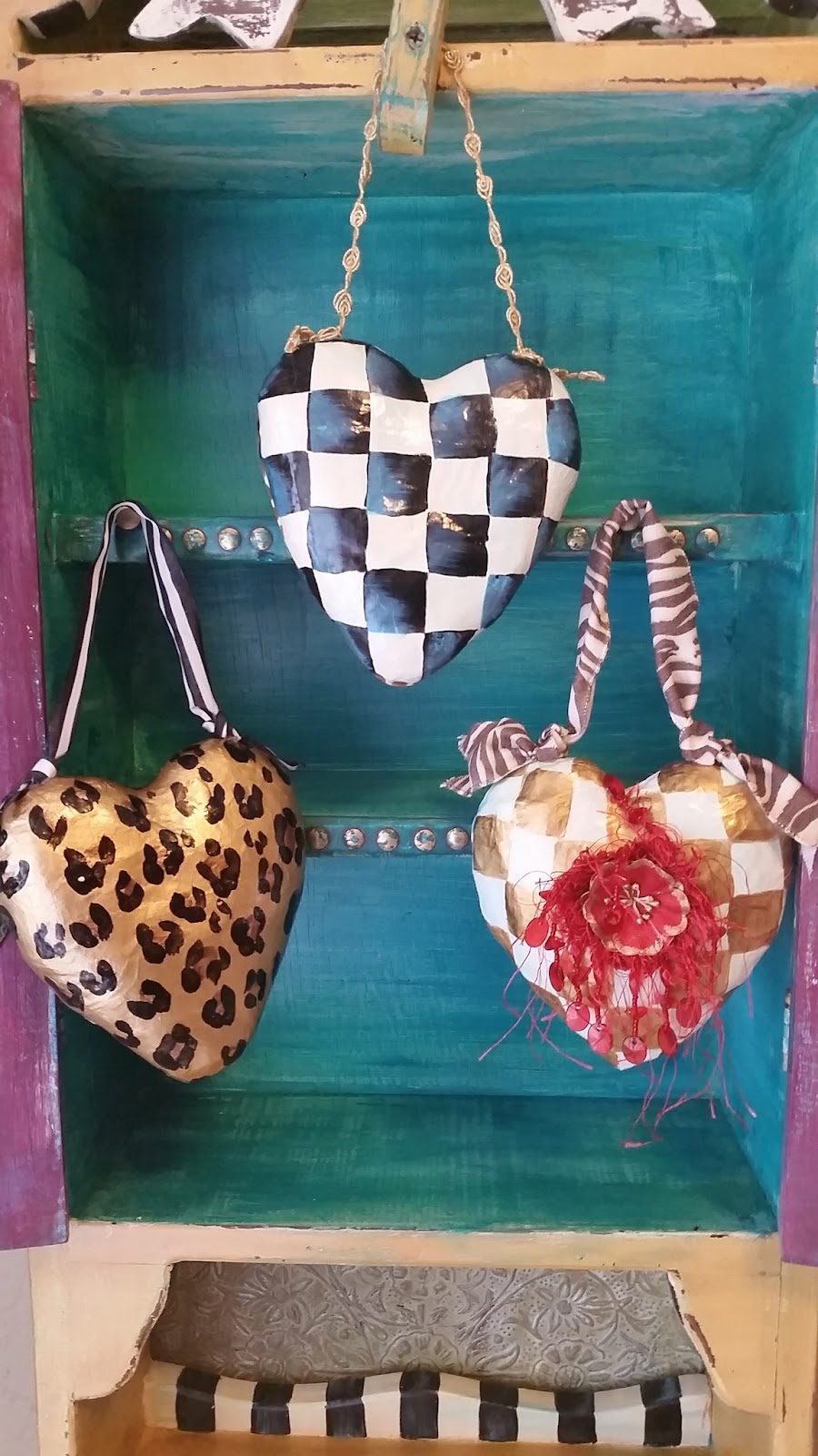 hand painted whimsical paper mache heart ornaments