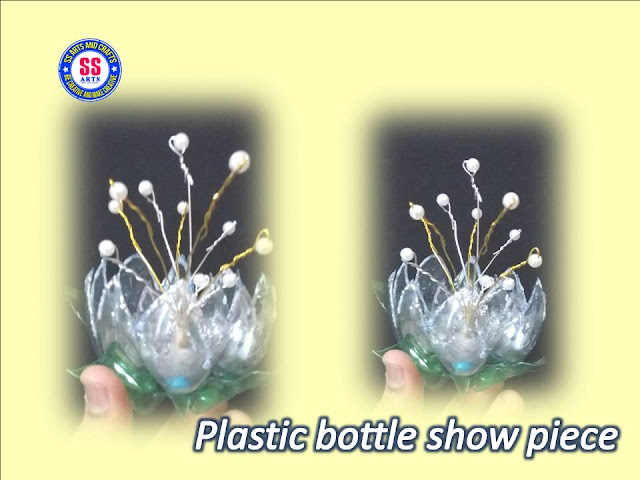 Here is plastic bottle crafts for kids,plastic bottle kids project works,plastic bottle wall decor,plastic bottle hangings,plastic bottle lamp,plastic bottle pets making for kids crafts,best out of the waste crafts,plastic bottle table center show piece,plastic bottle mini shelves