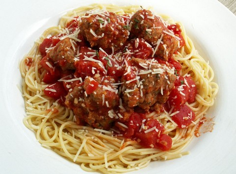 Lip smacking cheesy meatballs on top of spaghetti