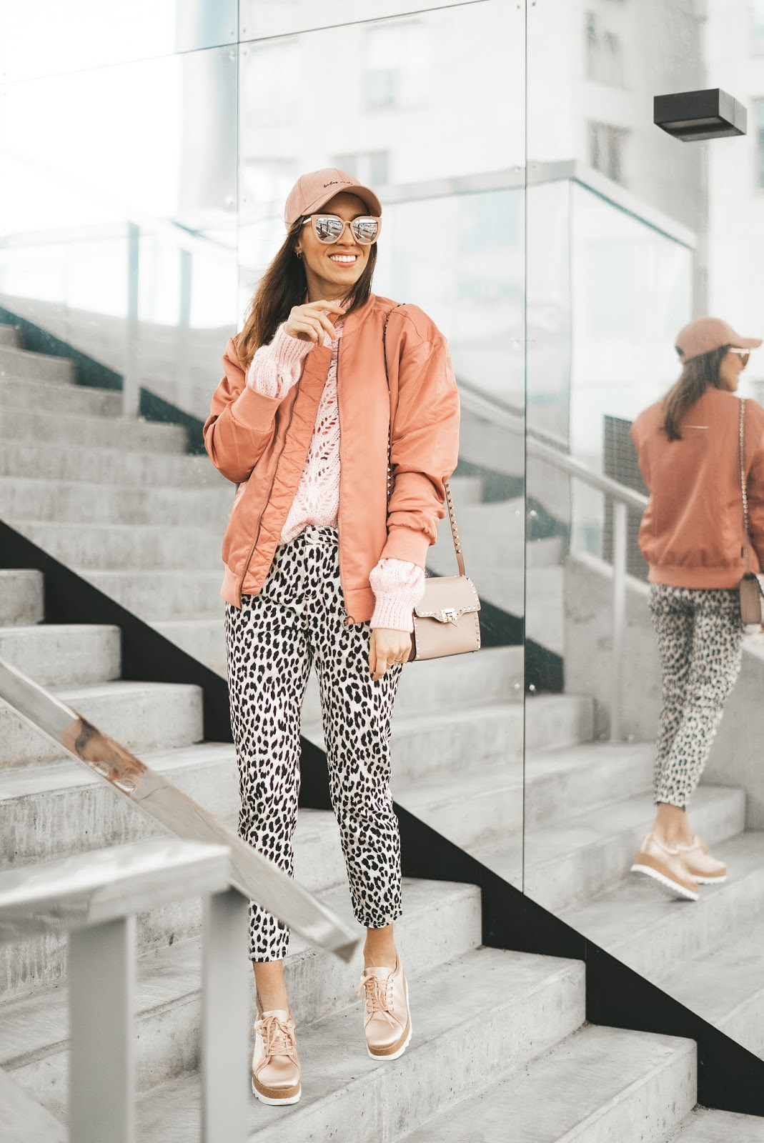 pink bomber jacket leopard print pants spring outfit