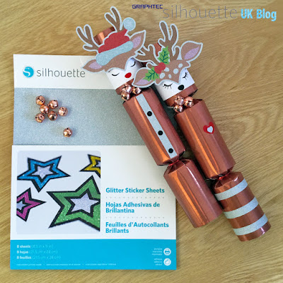 Custom Christmas Crackers designed by Janet Packer (CraftingQuine) for the Silhouette UK Blog using Silhouette Adhesive Glitter Sticker Sheets.