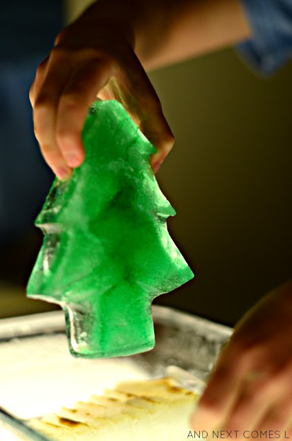 Science activities for Christmas: melting ice with salt on the light table