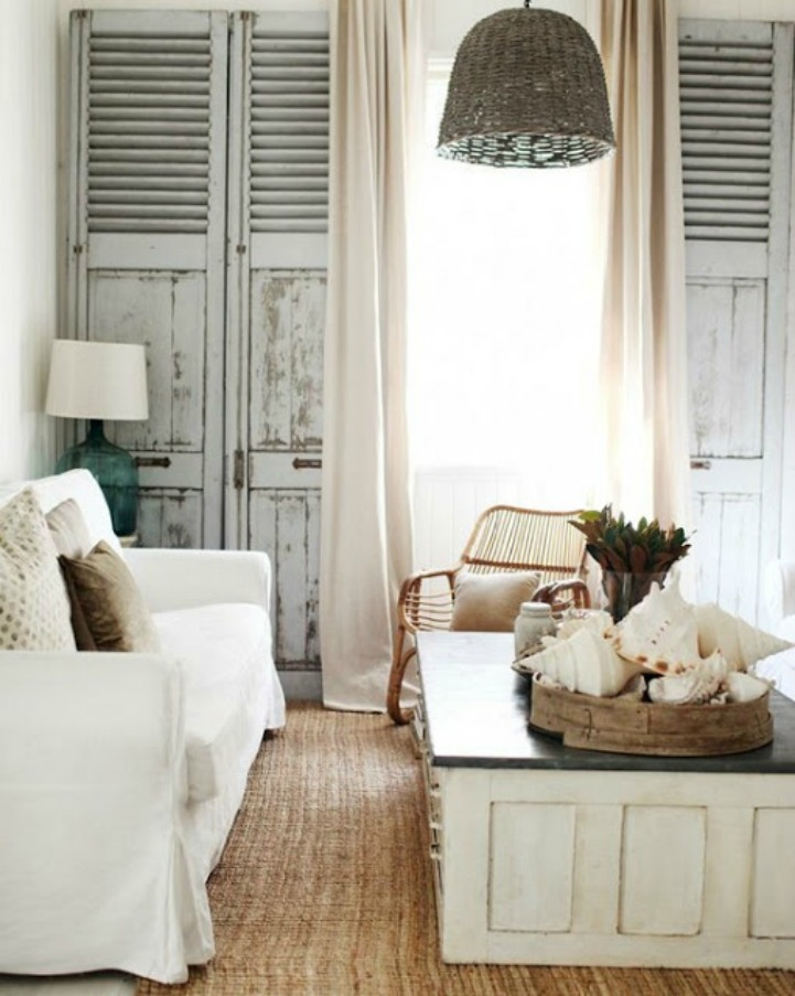 Coastal shabby chic decor with white slipcover sofa and rattan chandelier