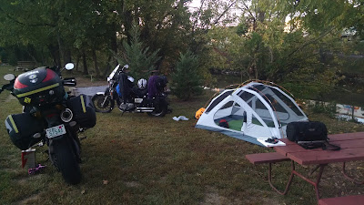 Bumblebee, Hades, the tent, and a picnic table by the edge of the river at KOA
