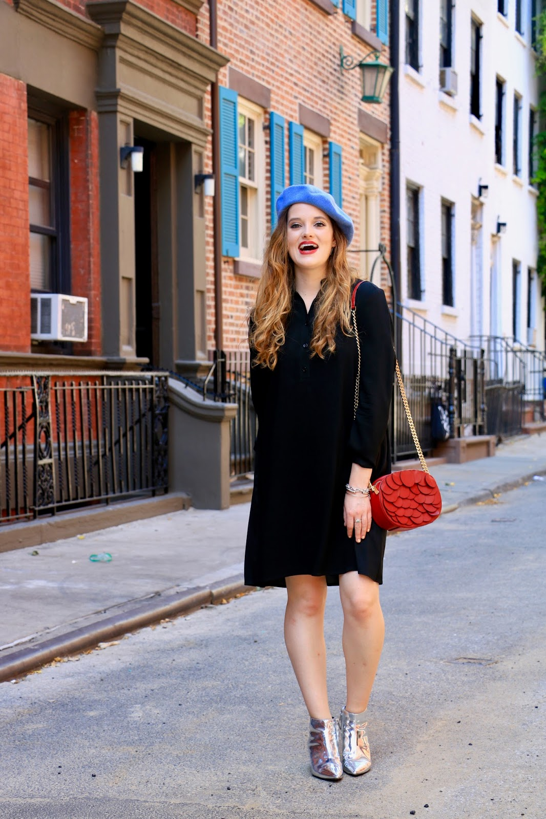 Fashion blogger Kathleen Harper showing off how to wear a beret