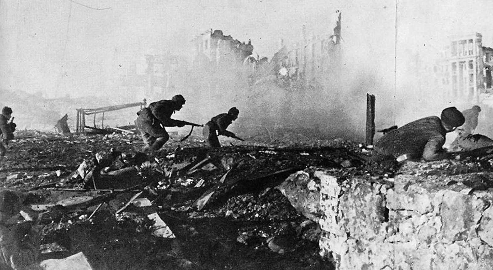 Sometime in the Autumn of 1942, Soviet soldiers advance through the rubble of Stalingrad.