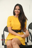 Actress Poojitha Stills in Yellow Short Dress at Darshakudu Movie Teaser Launch .COM 0216.JPG
