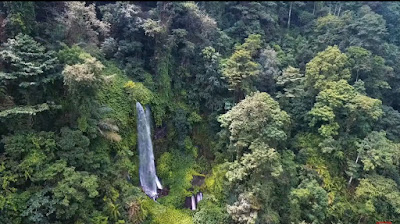 A royalty free of aerial drone shot of Sendang Gile Waterfall