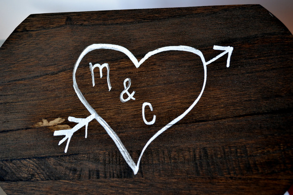 M & C in heart on wooden box