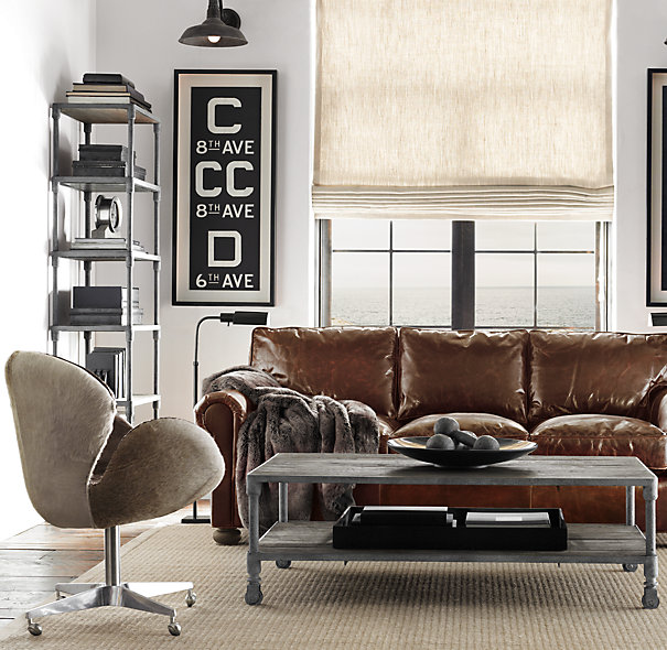 Restoration Hardware living room with rustic industrial coffee table - found on Hello Lovely Studio