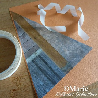 Double sided tape sticks the triangle flag onto a plain orange color cardstock