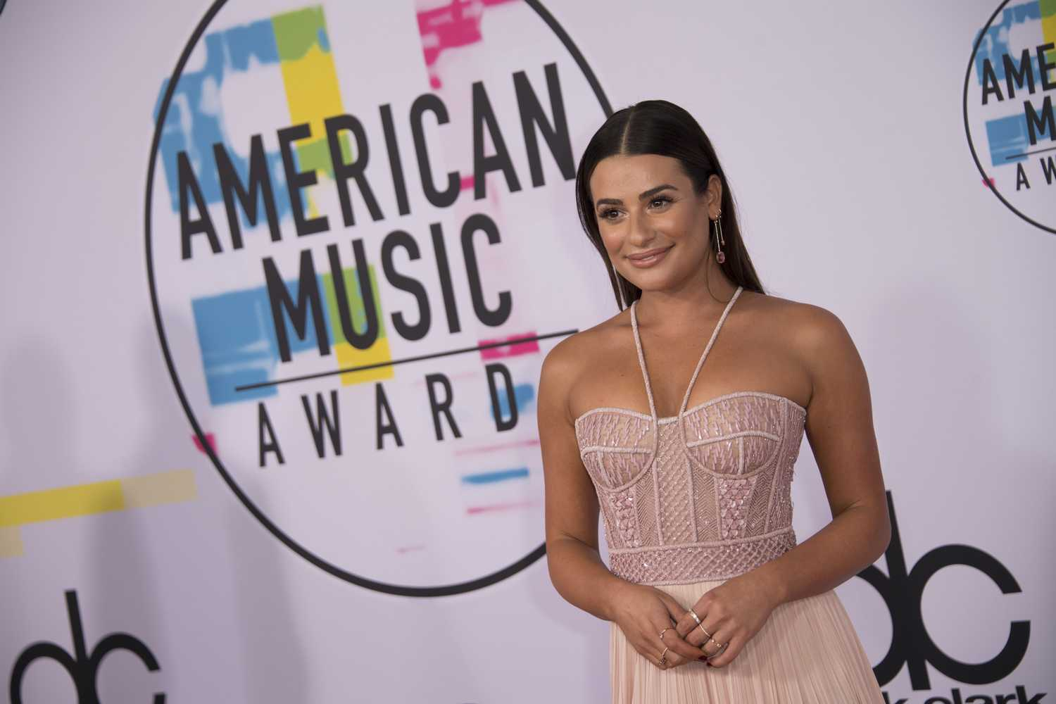 Lea Michele arrives in corseted pink gown to the 2017 AMAs
