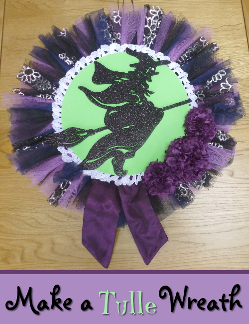 Purple and green witch on a broomstick wreath